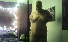 Big Blonde Woman Doing A Striptease
