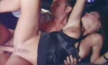Hot brunette sucking cock and fucking on backseat of a limo