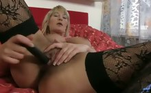 Sexy blonde cougar with huge natural tits strips off her