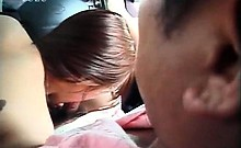 Japanese hot MILF blowing one dick after another in a van